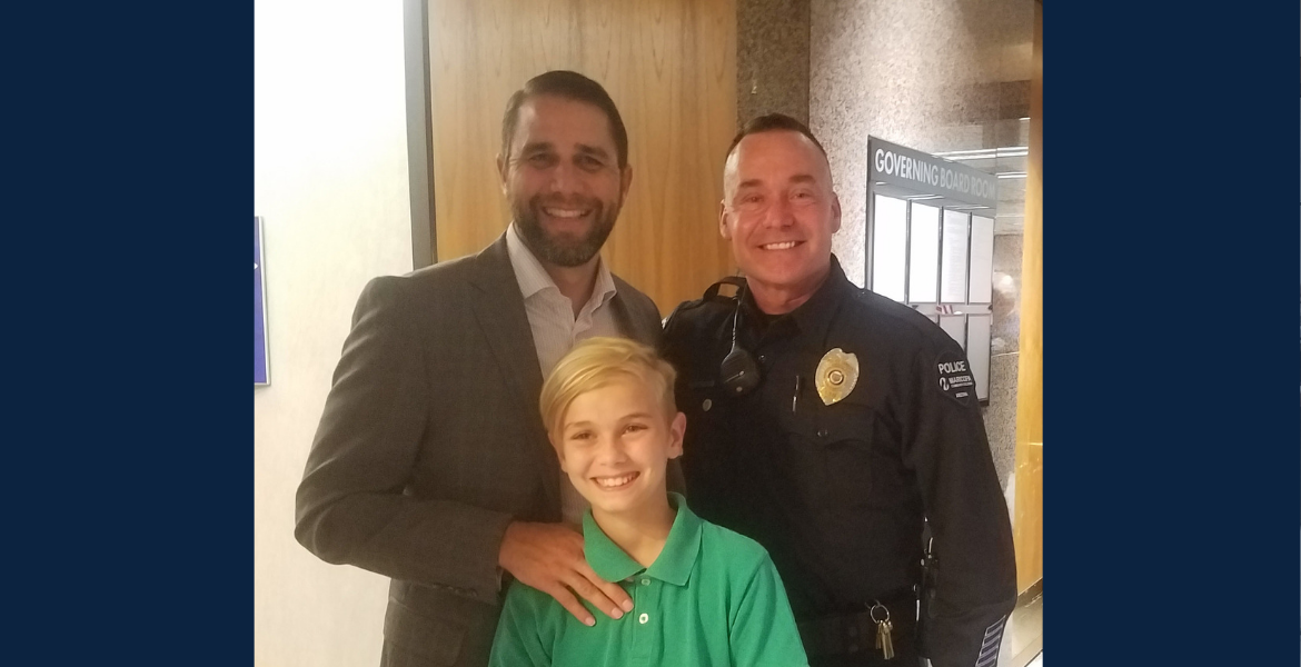 Man, whose life was saved by Officer Gilbreth, and son.